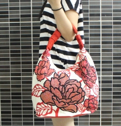 Beaded on printed rose handbag