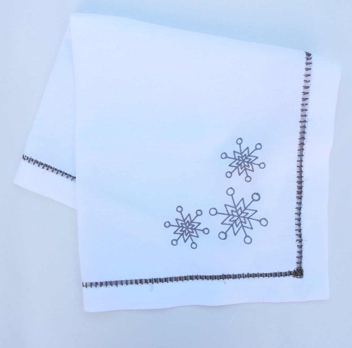 Snowflake embroidered Christmas dinner napkin with hand hemstitch