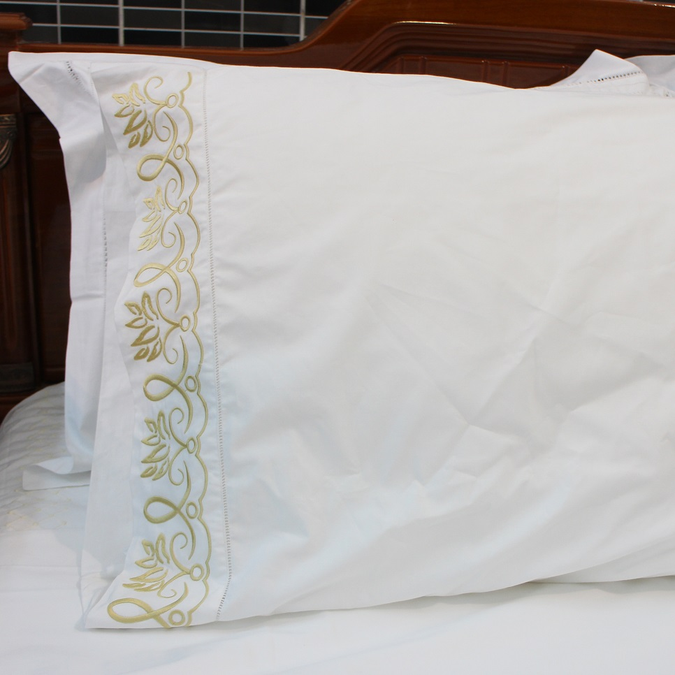 Abstract lotus embroidered pillowcase with hemstitch in gold