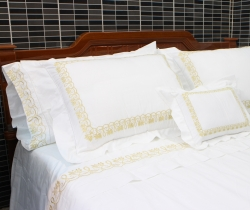 Gold lotus flowers embroidered bedding set with hemstitch